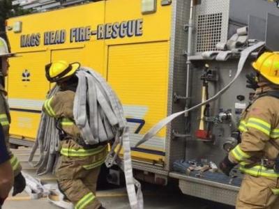 putting away hose after a fire, Nags Head, NC