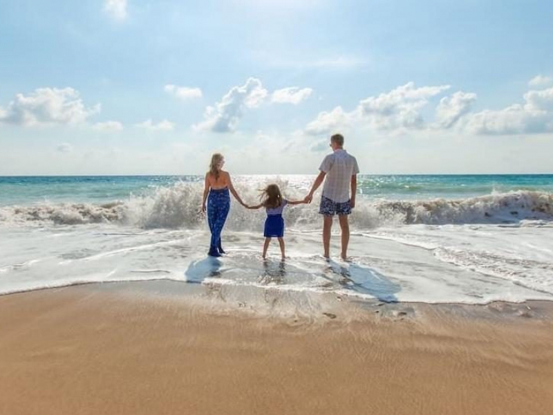 Family enjoying Kill Devil Hills beach in NC
